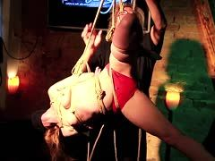 Masked blonde is hogtied with pleasure