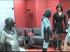 Slave has to wear an inflatable latex suit