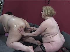 Fat lesbians play with huge dildo out of glass