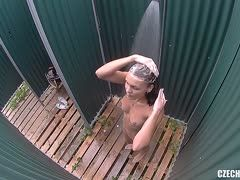 Horny brunette is filmed in the shower