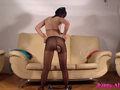 Submissive minx in nylons masturbates