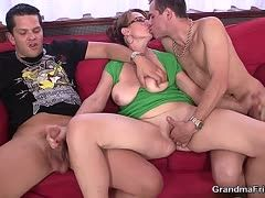 Fully mature bitch is anal fucked by two guys on the sofa