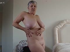 Horny granny unpacks her buxom boobs