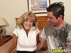 Blonde granny is keen on the young guy