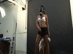 Sex model poses with gas mask