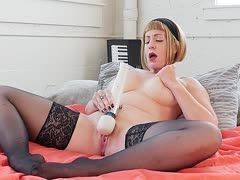 Milf with XXL boobs masturbates herself to an intense climax