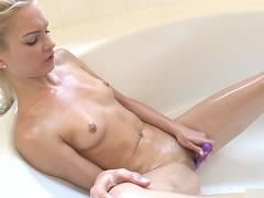 Young girl with small tits masturbates in the bathroom