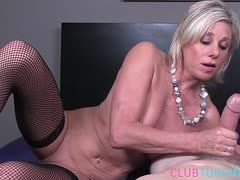 Sexy milf jerks the cock off