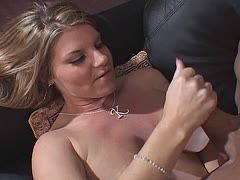 Mature blonde wanks her husband's cock