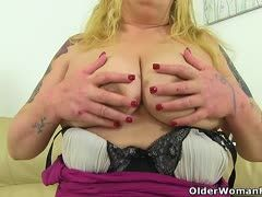 Blonde granny with giant tits fucks her dildo