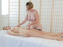 Naked masseuse works on a blonde girl
