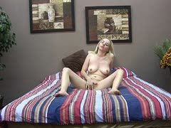 Blonde girl plays with dildo