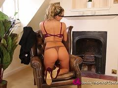 Sexy milf has solo sex in the armchair