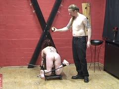 Rough torture for the hogtied slave